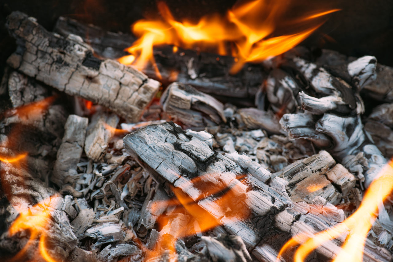 close-up-of-bonfire-with-flame-and-firewood-outdoo-C3UUGRR-1280x854.jpg